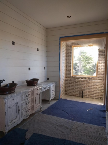 Master Bathroom Cabinets and Overgrouted Brick Tub Niche