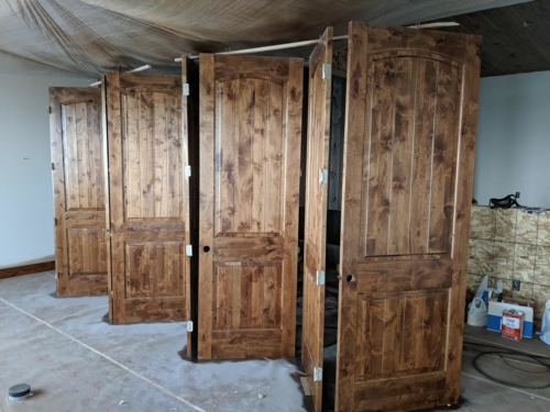 Stained Knotty Alder Doors